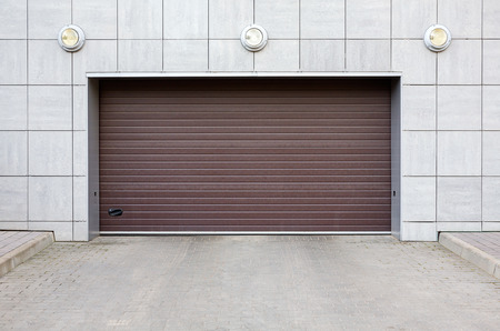 Modern building wall with closed garage gate photo