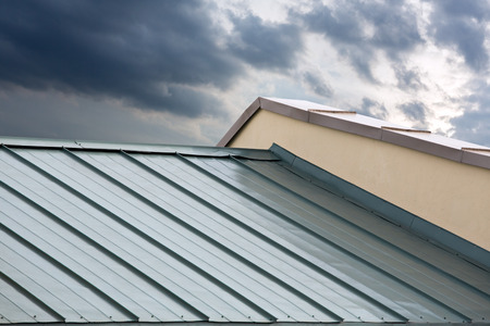 metal structure: New corrugated metallic gray roof of new house Stock Photo