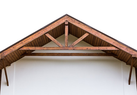 roof beam: Gable of new home with wooden roof rafters Stock Photo