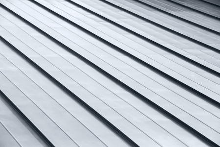 New corrugated metallic gray roof surface background Archivio Fotografico