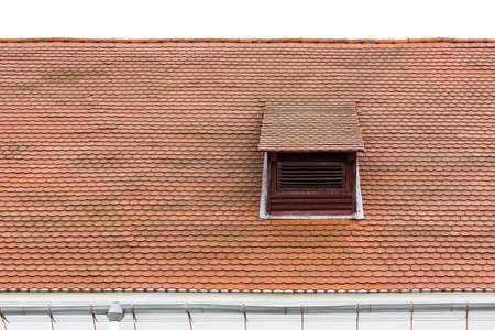 dormer: Weathered red tiled roof with dormer window