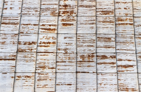 Old rusty corrugated metallic grey roof background photo