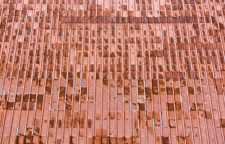 Old rusty corrugated metallic red roof texture photo
