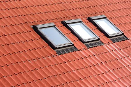 Modern orange tiled roof with three skylights