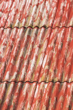 Red painted corrugated asbestos cement roof background photo