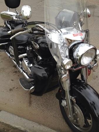 shiny metal: Black motorcycle on road