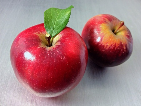 shiny metal: Two red apples