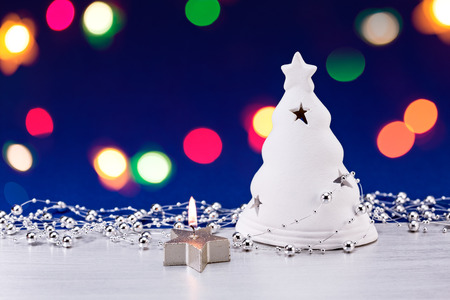 Christmas tree figurine with burning candle ornament photo