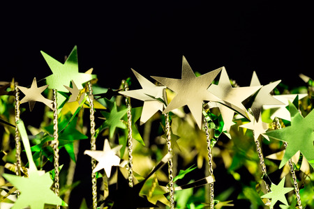 Christmas or New Year holiday ornament with golden stars photo