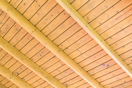 Beams structure on the wooden ceiling of a new home photo
