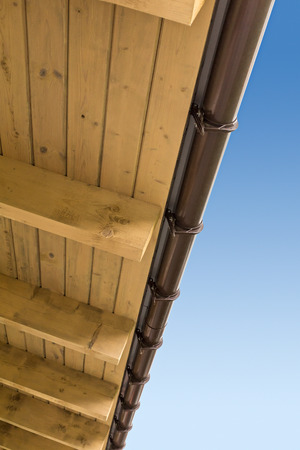rafters: Closeup view of roof with wood rafters and planks