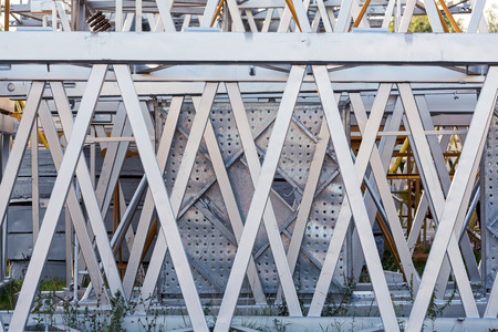 heavy joist: Stacked steel frames of old tower cranes