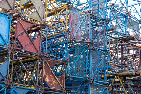 steelwork: Stacked pieces of steel structure of old disassembled building cranes Stock Photo