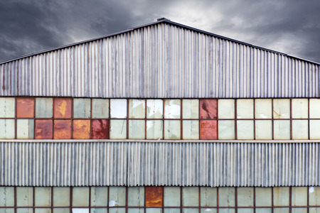 Abandoned old factory building with broken window photo