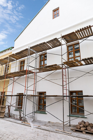 reconstruction: Old building facade with scaffolding under reconstruction