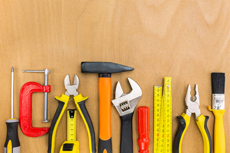 straight line: Work tools lined up in a straight line on wooden background