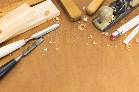 chisels: Carpenter plane, chisels, folding rule and wooden planks Stock Photo