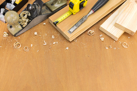 shavings: Woodworking tools with shavings and wooden planks Stock Photo