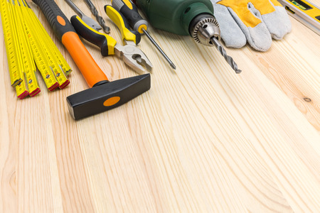 Set of working tools on wooden background with copy space photo