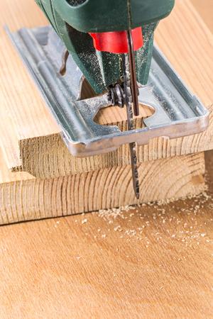 Electric fretsaw tool cutting wooden planks closeup Stok Fotoğraf