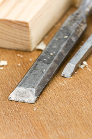 chisels: Used carpenter wood chisels tool with planks and shavings Stock Photo