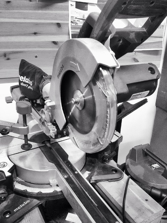 industrial: Compound mitre saw in a workshop