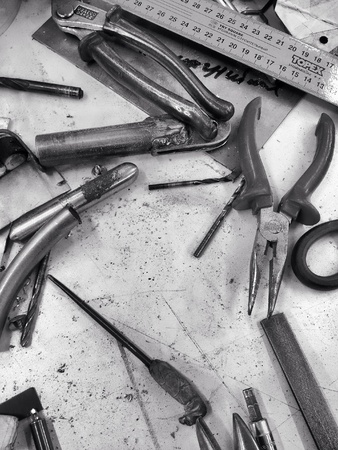 metal: Set of working tools on scratched metal surface