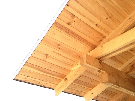 rafters: Wooden rafters in a corner roof of house