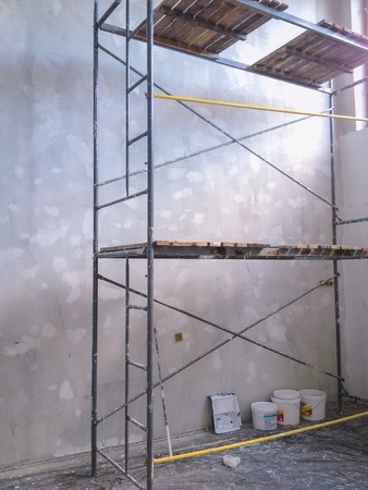 scaffold: Renovation home. Empty room with scaffold