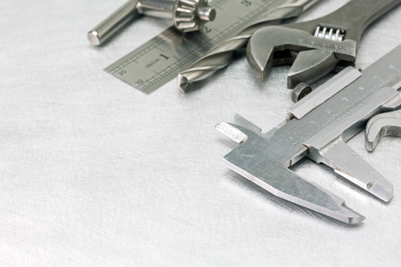 vernier caliper: Set of  metal working tools on scratched background Stock Photo