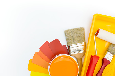 paint roller in tray brushes and paint can with color guide Stock Photo