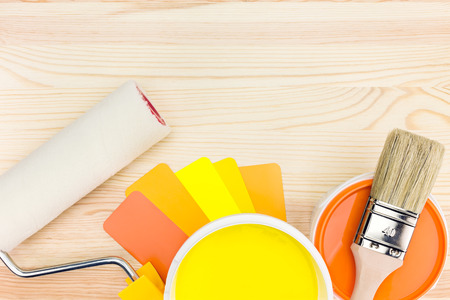 brush and roller with color guide and paint can Stock Photo