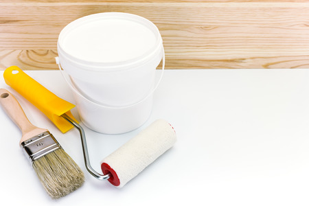 paint can with roller and brush for home renovation photo