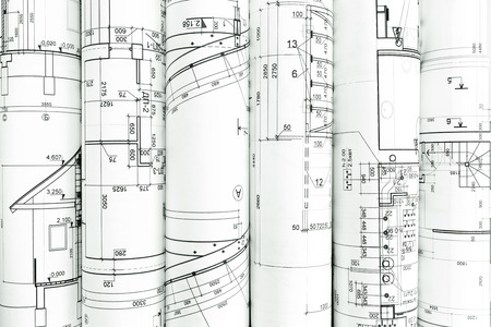 architectural  detail: rolls of architecture blueprints and technical drawings architectural background