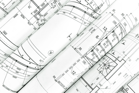 rolls of architecture blueprints and technical drawings architectural background