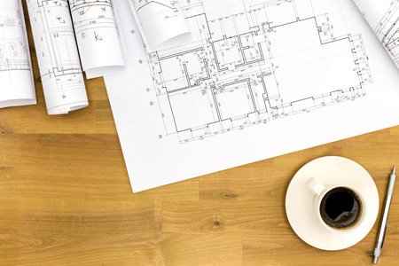 blueprint: coffee cup and architectural blueprints on working table
