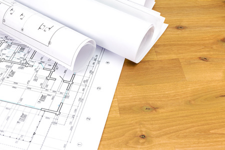architectural background with floor plans and rolled technical drawings Stockfoto