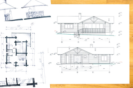 designers hand drawing with house plan blueprints
