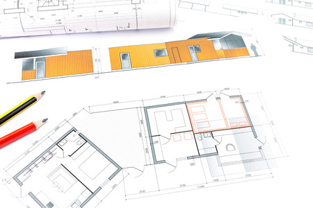 house blueprints: architects workspace with house blueprints and rolled plans