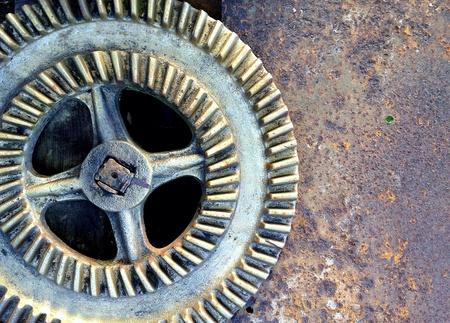industrial: Rusty metallic gear wheel of old industrial machinery