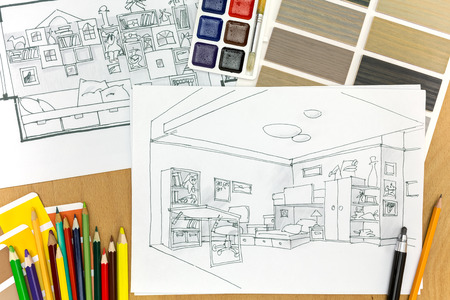 design drawing: top view of architecture hand-drawn sketch on a wooden background with color sample and pencils