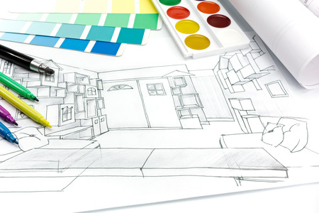 construction plans: architectural plans of room interior on a desk with painting tools