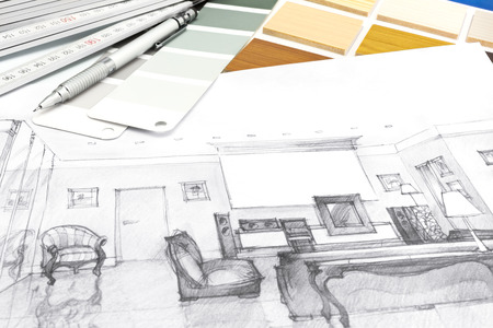 design drawing: designers desk with a living room sketch and drawing tools on it