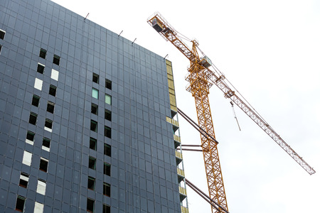 building construction site with yellow tower crane