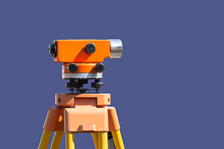 land surveying: land surveying equipment theodolite at construction site Stock Photo