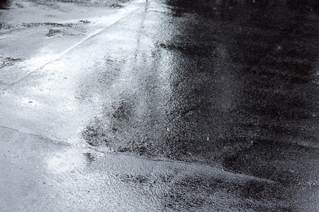 rainy season: wet asphalt sidewalk background after heavy rain Stock Photo