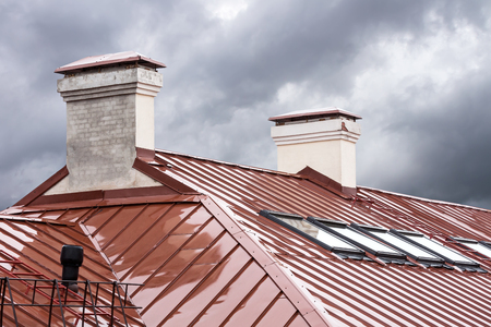 skylights: new red metal roof with skylights and chimneys