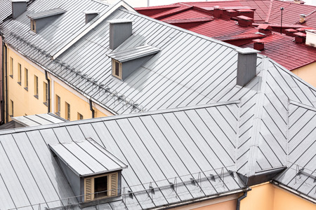 roofing: wet new metal roofs of old houses viewed from above