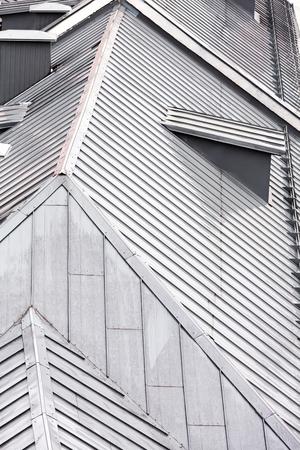 chimney corner: top view on grey metal roof of the old city houses Foto de archivo