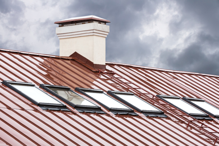 skylights: new red metal roof with skylights and chimney